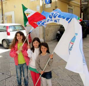 Girls posing with their Berlusconi flags